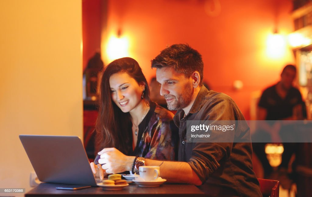 Young people working late in the Belgrade cafe : Stock Photo