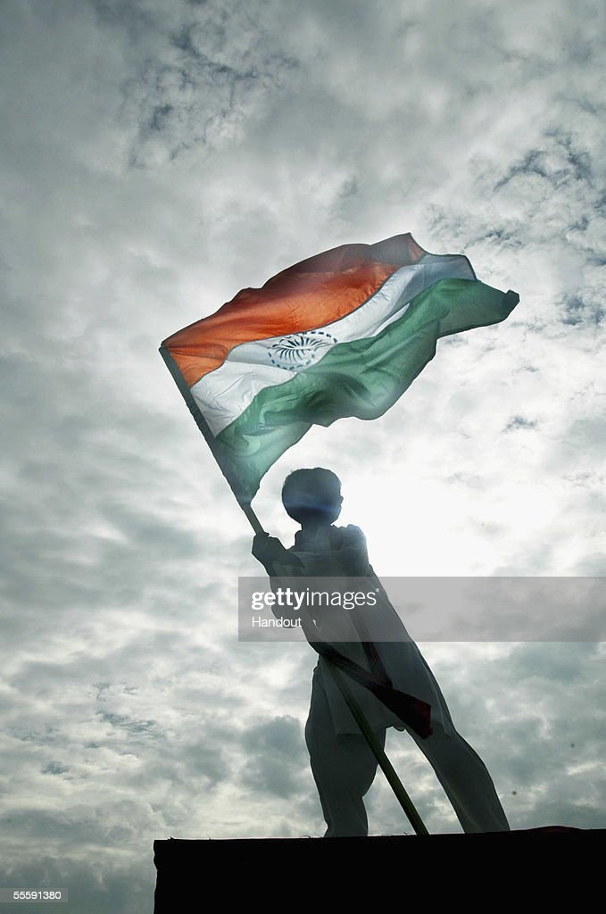 A young performer waves his country's national flag as he stands a top a high tower during celebrations to mark the Melbourne 2006 Queen's Baton's arrival at Noida Stadium September 14, 2005 in Noida, India. The Baton arrives in Australia on January 24, 2006. Upon its arrival some 3500 relay runners will carry the baton across Australia in the final 50 days of its epic 180,000 kilometre journey from Buckingham Palace, London, to the opening ceremony of the Melbourne 2006 Commonwealth Games.