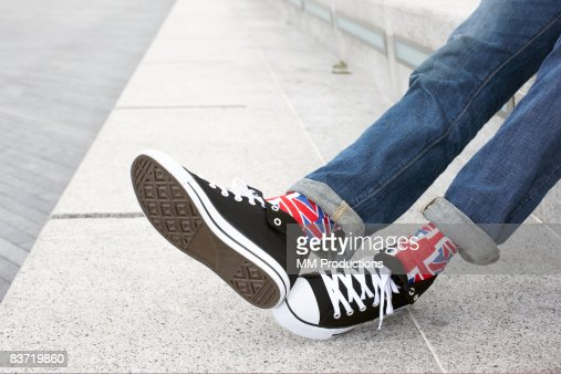 Young person wearing Union Jack socks : Stock Photo