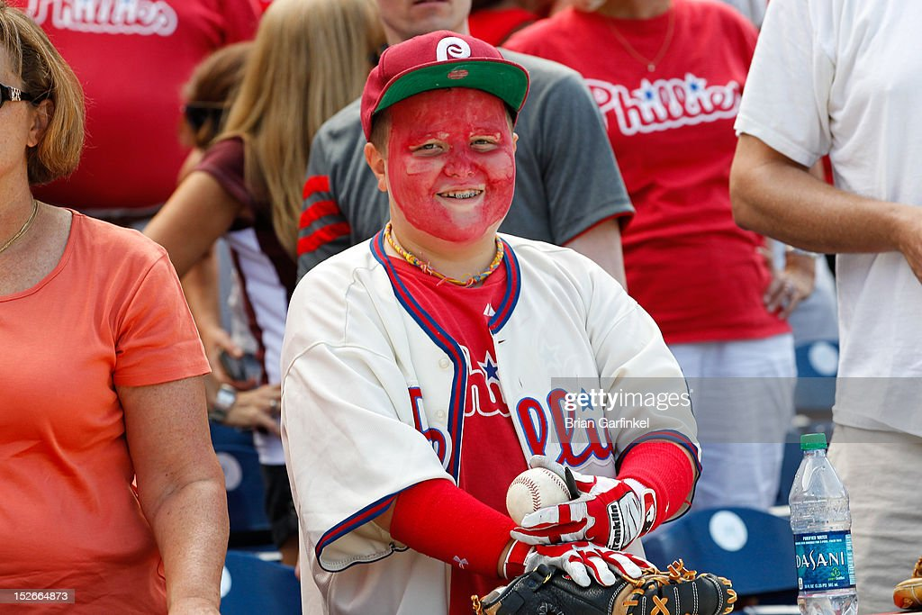 A young Philadelphia Phillies fan is seen smiling with his face painted after the game against the Washington Nationals at Citizens Bank Park on August 26, 2012 in Philadelphia, Pennsylvania. The Phillies won 4-1.