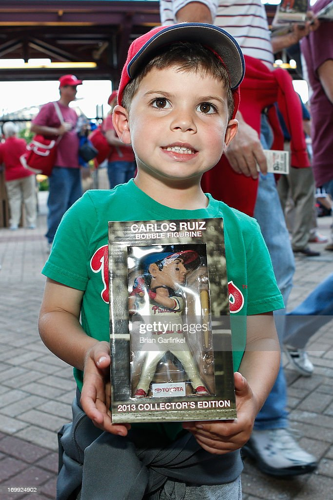 A young Philadelphia Phillies fan poses for a picture with his Carlos Ruiz bobble head before the game against the Miami Marlins at Citizens Bank Park on June 4, 2013 in Philadelphia, Pennsylvania.