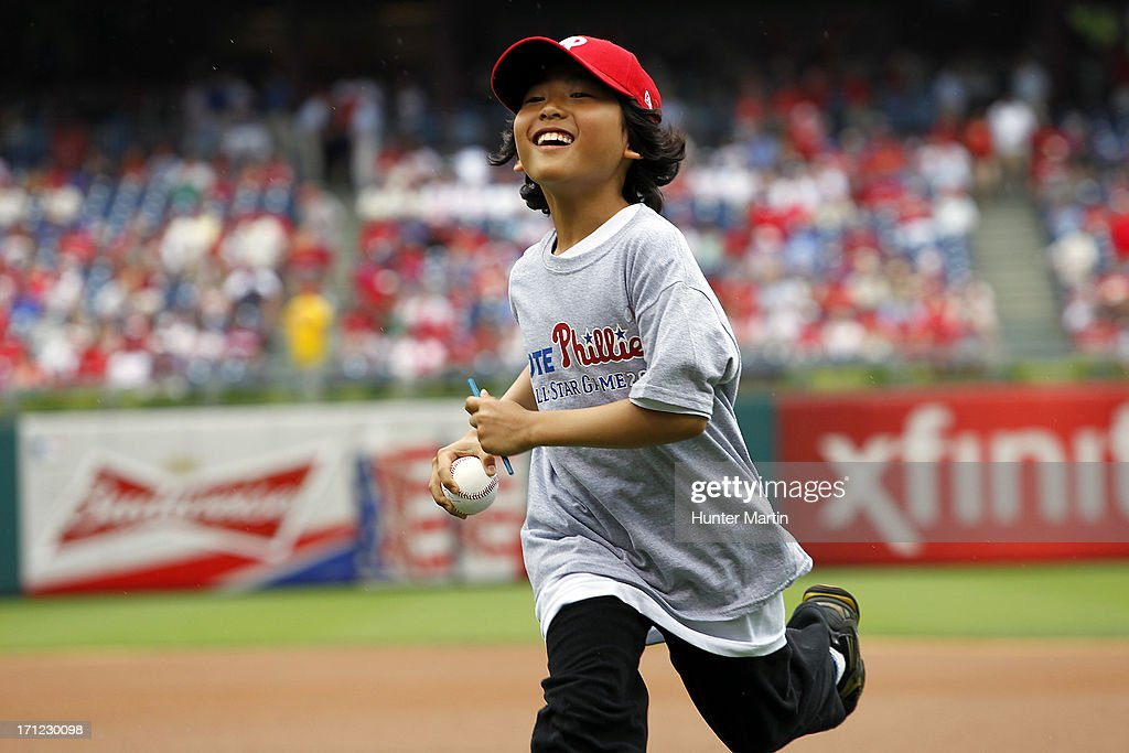 A young Philadelphia Phillies fan runs off the field after getting a ball and an autograph before a game against the New York Mets at Citizens Bank Park on June 23, 2013 in Philadelphia, Pennsylvania. The Mets won 8-0.