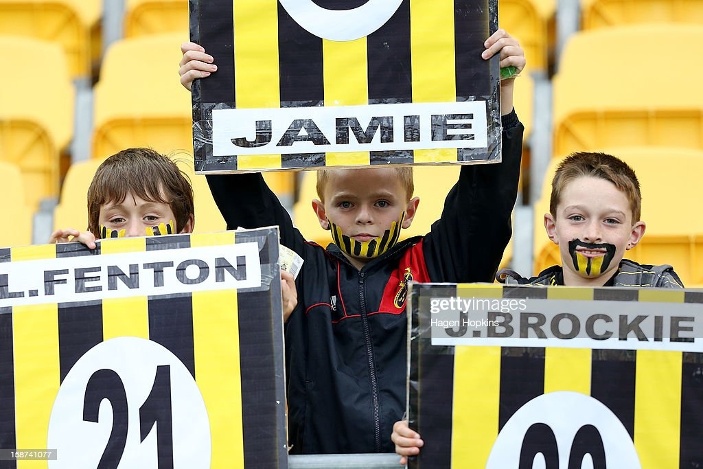 Young Phoenix fans show their support during the round 13 A-League match between the Wellington Phoenix and the Melbourne Heart at Westpac Stadium on December 27, 2012 in Wellington, New Zealand.