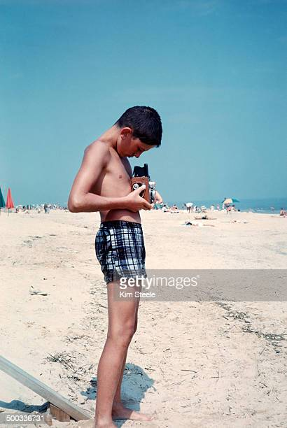 Young  photographer on beach with camera