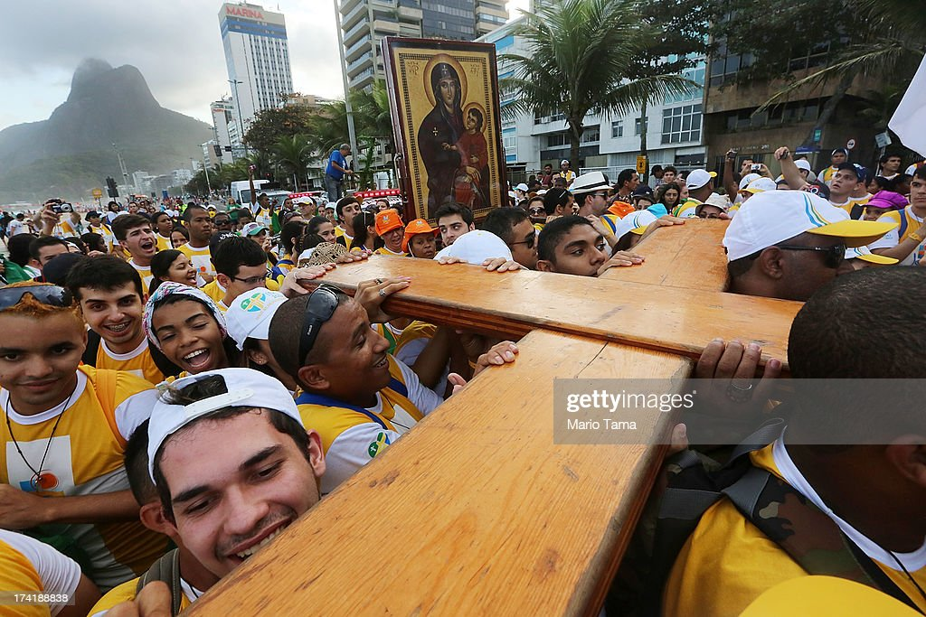Young pilgrims carry the World Youth Day Cross along Ipanema Beach on July 21, 2013 in Rio de Janeiro, Brazil. More than 1.5 million pilgrims are expected to join Pope Francis for his visit to the Catholic Church's World Youth Day celebrations. Pope Francis is scheduled to visit Brazil from July 22 to 28.