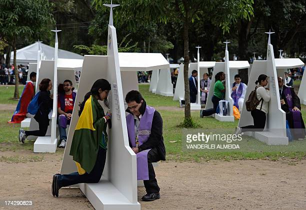 Young pilgrims confess at the Quinta da Boa Vista park in Rio de Janeiro Brazil on July 23 2013 Pope Francis's popularity on his Latin American home...