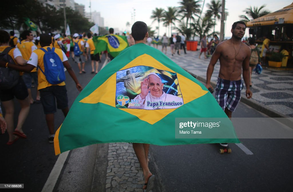 Young pilgrims (L) march along Ipanema Beach on July 21, 2013 in Rio de Janeiro, Brazil. More than 1.5 million pilgrims are expected to join Pope Francis for his visit to the Catholic Church's World Youth Day celebrations. Pope Francis is scheduled to visit Brazil from July 22 to 28.