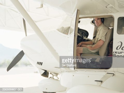 Young pilot in cockpit of private plane : Stock Photo