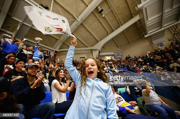 A young Pittsburgh Penguins fan cheers during the third period of the NHL Kraft Hockeyville USA preseason game between the Pittsburgh Penguins and...