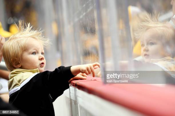 A young Pittsburgh Penguins fan looks on from the first row during the second period in Game One of the Eastern Conference Final in the 2017 NHL...