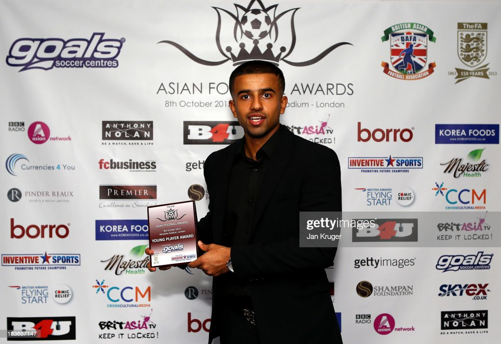 Young Player Award winner Adil Nabi poses during the Second Annual Asian Football Awards at Wembley Stadium on October 8, 2013 in London, England.