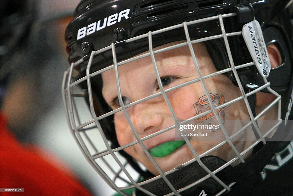 A young player taking part in a hockey clinic run by NHL Alumni is all smiles at the Stirling and District Recreation Centre during Kraft Hockeyville Day 2 on October 1, 2012 in Stirling, Ontario, Canada.
