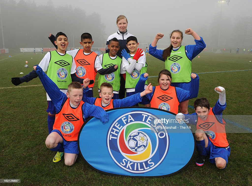 Young Players pose with coaching staff during the Tesco Skills Extra Launch at St Georges Park on March 5, 2013 in Burton-upon-Trent, England.