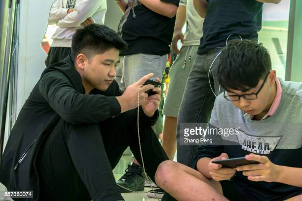 Young players practice the mobile game Arena of Valor prepared for the battle match held in a shopping mall Arena of Valor 5v5 Arena Game China's...