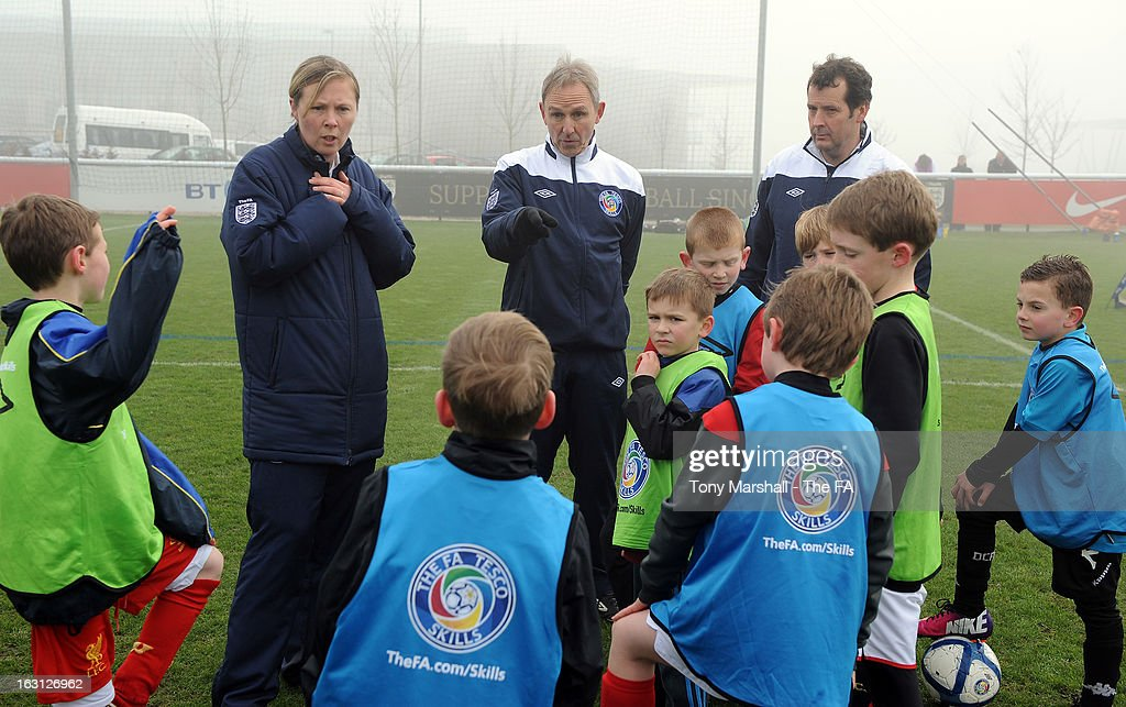 Young players receive coaching tips from The FA's Peter Burgess (C) and other members of the coaching team during the Tesco Skills Extra Launch at St Georges Park on March 5, 2013 in Burton-upon-Trent, England.