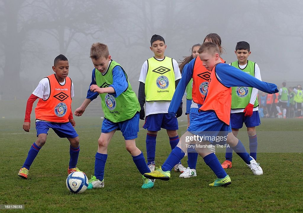 Young players take part during the Tesco Skills Extra Launch at St Georges Park on March 5, 2013 in Burton-upon-Trent, England.