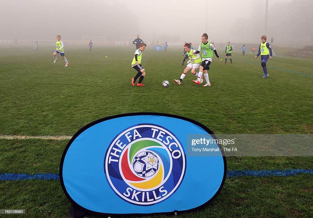 Young players take part in a coaching session at the Tesco Skills Extra Launch at St Georges Park on March 5, 2013 in Burton-upon-Trent, England.