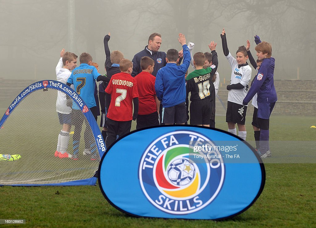 Young players take part in a coaching session during the Tesco Skills Extra Launch at St Georges Park on March 5, 2013 in Burton-upon-Trent, England.