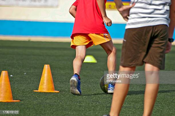 Young players training soccer