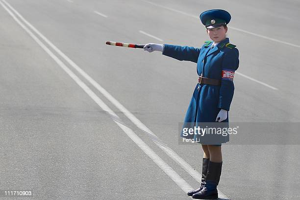 A young police woman conducts the traffic on April 3 2011 in Pyongyang North Korea Pyongyang is the capital city of North Korea and the population is...