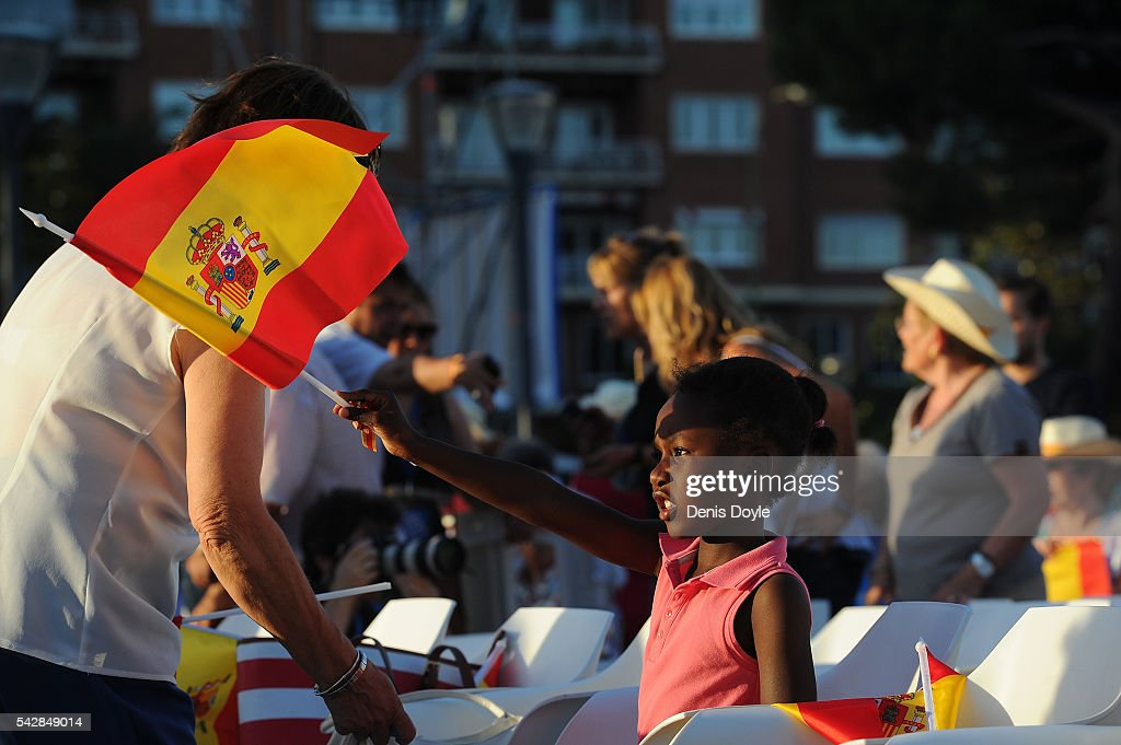 A young Popular Party supporter waves a Spanish flag during the closing rally ahead of Spanish General Elections on June 24, 2016 in Madrid, Spain. Spanish voters head back to the polls on June 26 after the last election in December failed to produce a government. Latest opinion polls suggest the Unidos Podemos left-wing alliance could make enough gains to come in second behind the caretaker government of the center-right Popular Party.