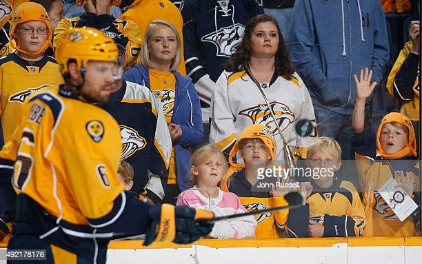 Young Predators fans watch Shea Weber of the Nashville Predators warmup against the Edmonton Oilers during an NHL game at Bridgestone Arena on...