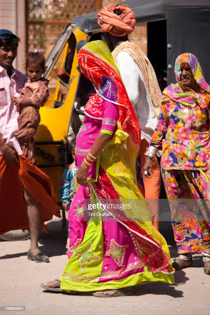 Young pregnant Indian woman, discreetly veiled, with her family in Sadri town in Pali District of Rajasthan, Western India