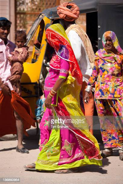 Young pregnant Indian woman discreetly veiled with her family in Sadri town in Pali District of Rajasthan Western India