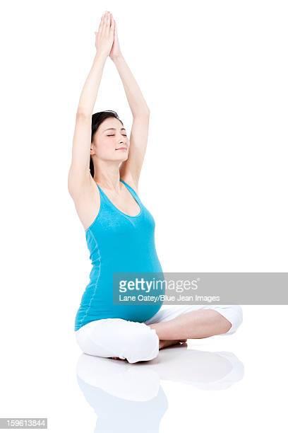 Young pregnant woman doing yoga