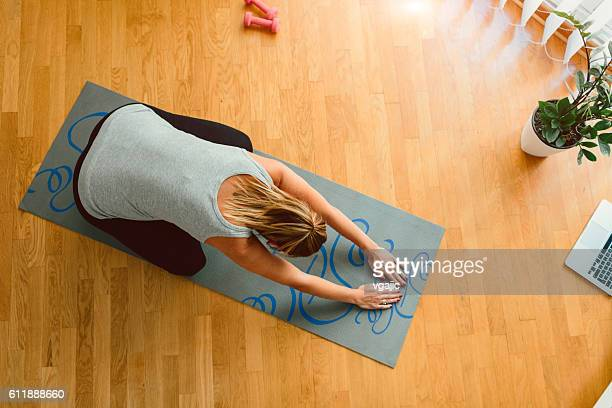 Young Pregnant Woman Exercise At Her Home