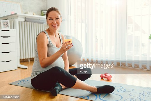Young Pregnant Woman Exercise At Home.