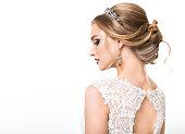 Young pretty caucasian bride in wedding dress at studio