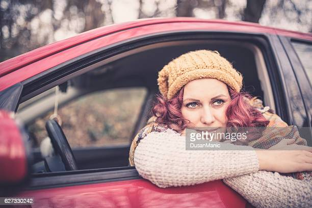 young pretty woman in her car