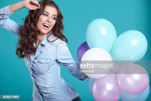 Young pretty woman with colored balloons : Stock Photo