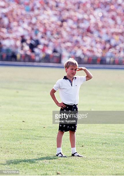 A young Prince William stands in the middle of Windsor polo ground in July 1986 in Windsor England