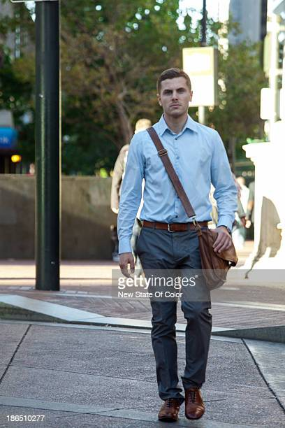 Young professional crossing the street in downtown