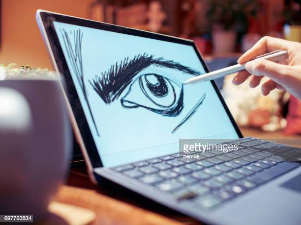 Young professional in creative office using graphic tablet