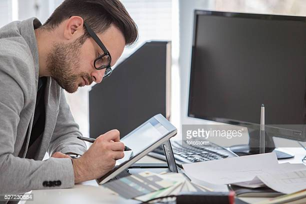 Young professional in creative office working on graphic tablet