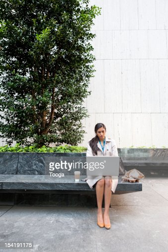 Young professional woman working on laptop : Stock Photo