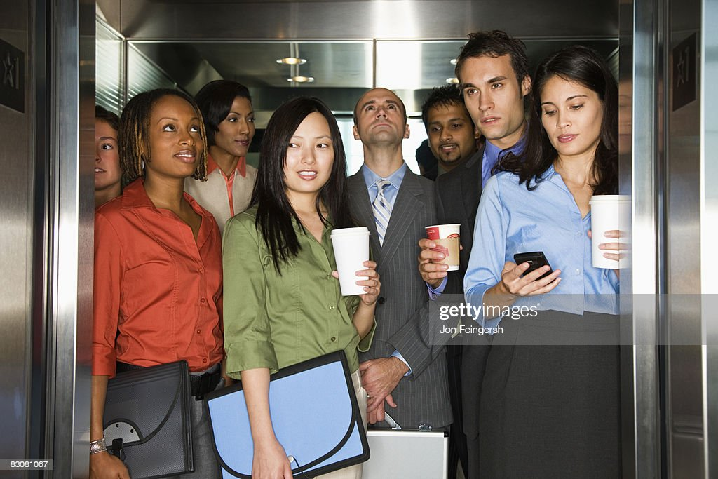 Young Professionals Arriving To Work : Stock Photo