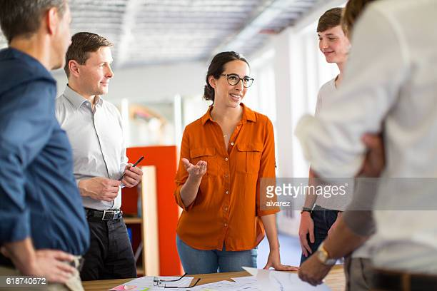Young professionals meeting around a table