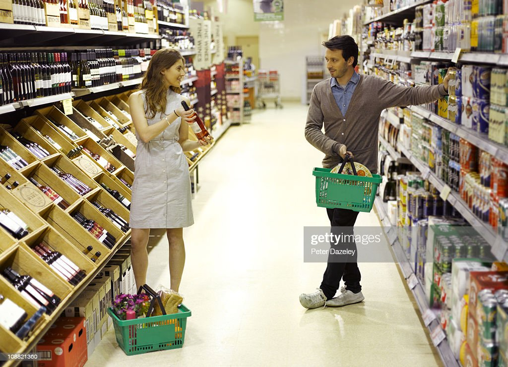 Young professionals supermarket dating : Stock Photo