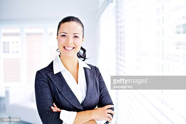 young professionnal women smiling and looking at the camera