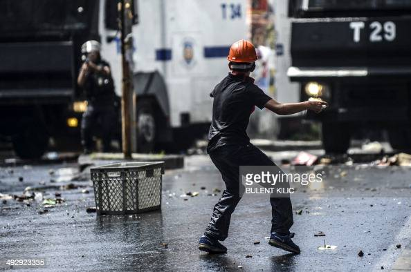A young protester throws objects at Turkish riot police during clashes on the sideline of a demonstration following the recent mine accident in Soma...