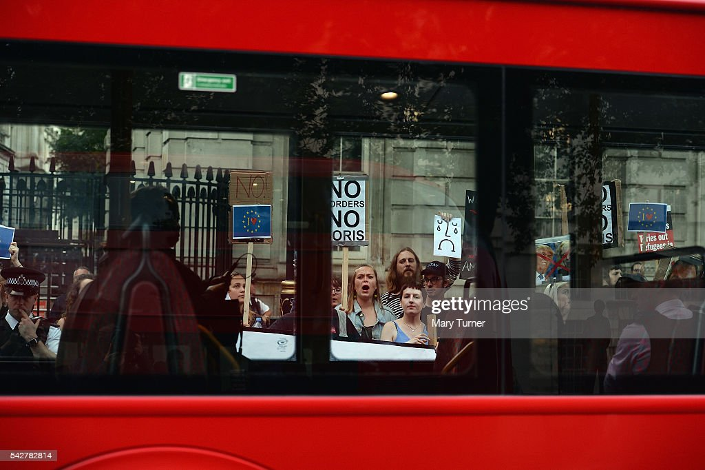 Young protesters and police are seen through the window of a London tourist bus, as they demonstrate outside Downing Street, following the United Kingdom's decision to leave the EU following the referendum, on June 24, 2016 in London, England. The result from the historic EU referendum has now been declared and the United Kingdom has voted to LEAVE the European Union.