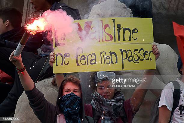 Young protesters holding a banner that reads 'The Valls line will pass nothing' march during a demonstration against the French government's planned...