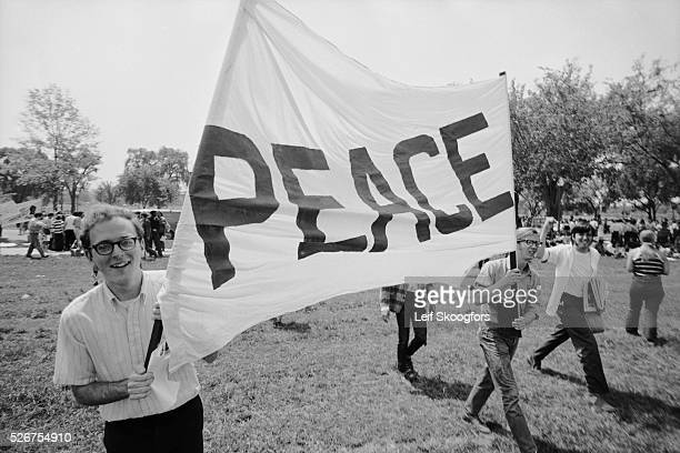 Young protesters in Washington DC carry a 'Peace' banner at a demonstration against the war in Vietnam and the killing of four students at Kent State...