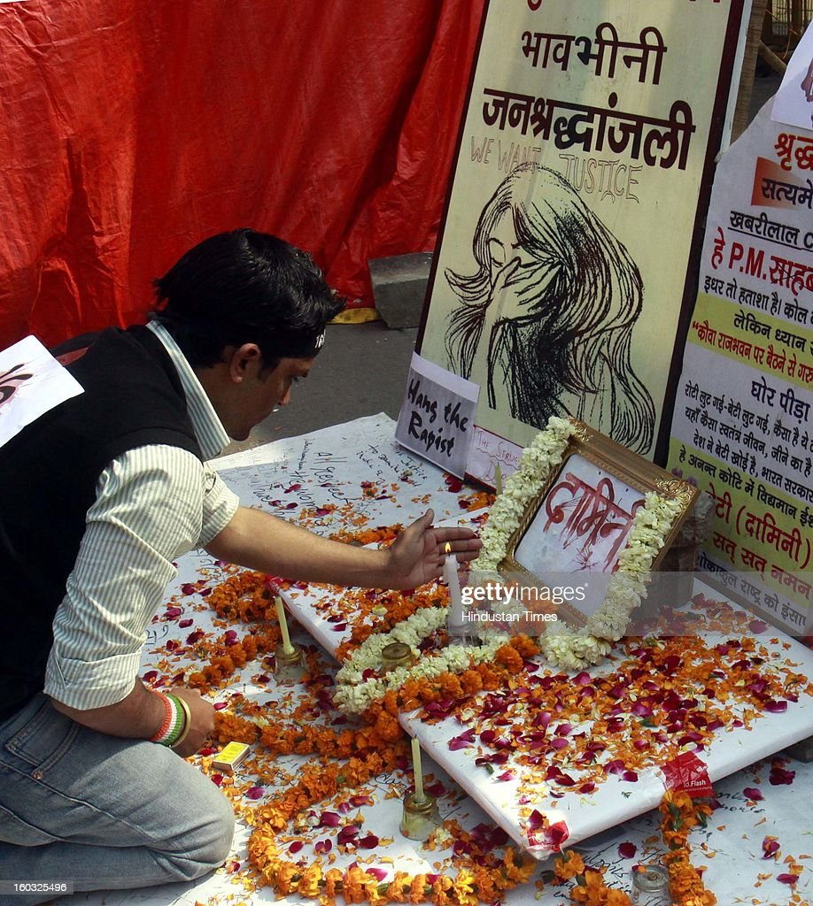 A young protestor lighting candle during a protest demanding the death penalty for six men accused of the fatal gang rape of a young woman last month at Jantar Mantar on January 29, 2013 in New Delhi, India.