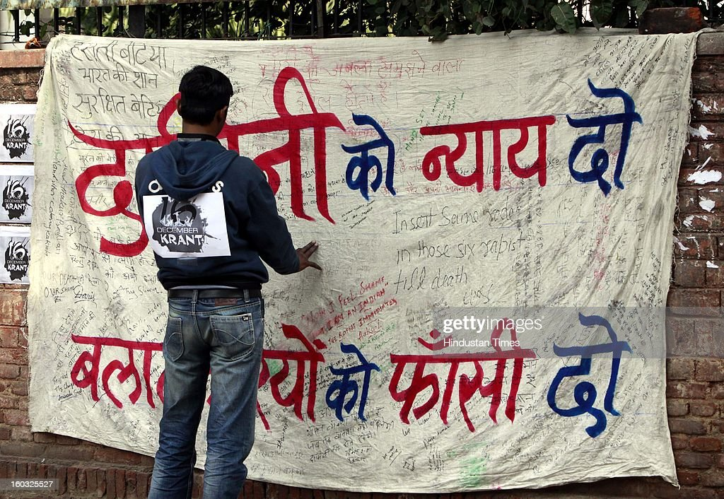 A young protestor signing banner during a protest demanding the death penalty for six men accused of the fatal gang rape of a young woman last month at Jantar Mantar on January 29, 2013 in New Delhi, India.