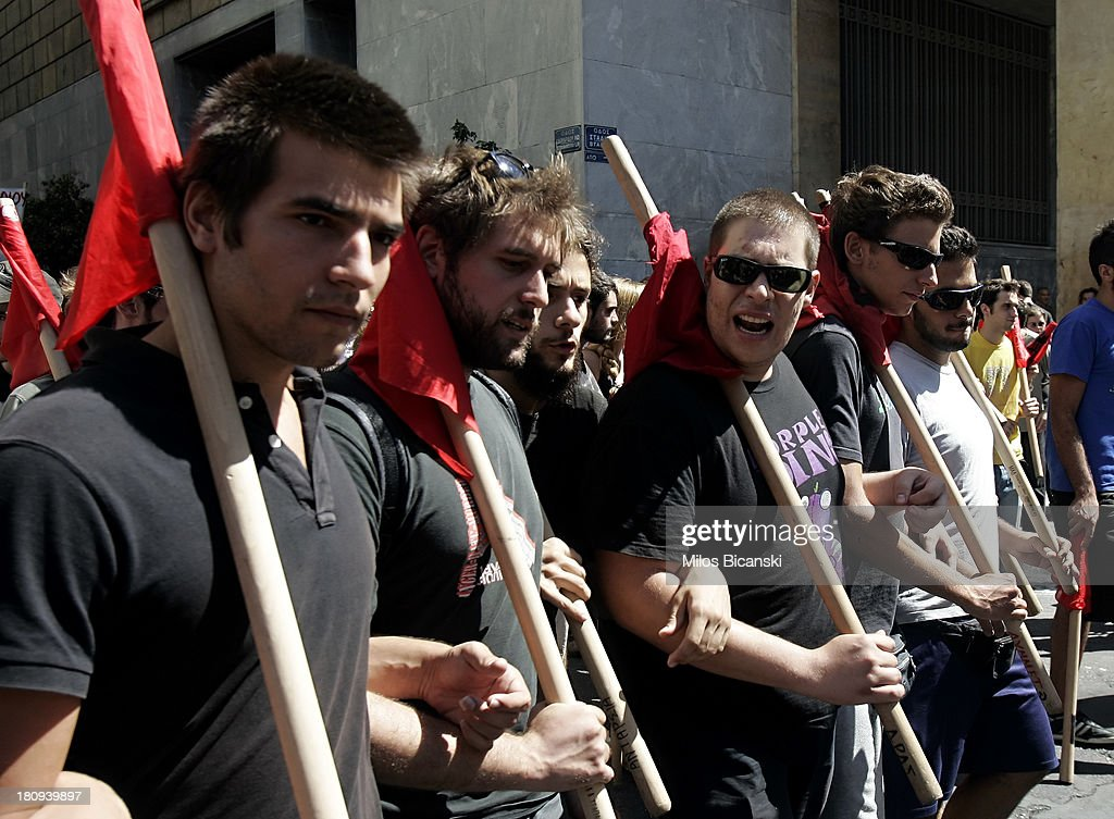 Young protestors hold banners during a demonstration against austerity and job cuts on September 18, 2013 in Athens, Greece. As part of the redeployment plan in the country reeling from six years of recession, civil servants have to accept new posts or spend eight months on reduced salaries as alternative posts are found, with the risk of losing their jobs altogether.